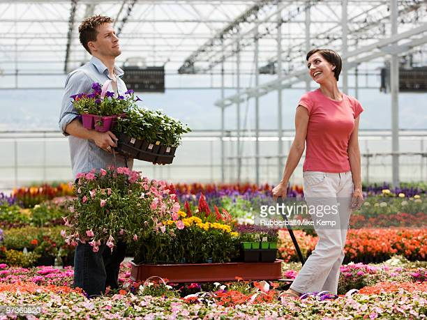 usa, utah, salem, couple with wagon in plant nursery - impatience flowers stock pictures, royalty-free photos & images