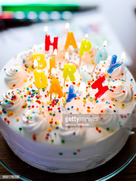 usa, utah, salt lake city, birthday cake on table - birthday cake stock photos and pictures
