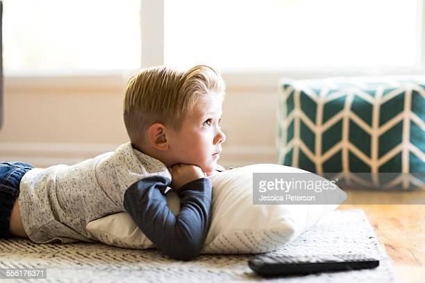 USA, Utah, Salt Lake City, Boy (4-5) watching tv in living room