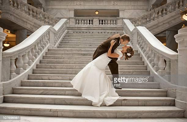usa, utah, salt lake city, bride and groom embracing on steps - utah wedding stock pictures, royalty-free photos & images