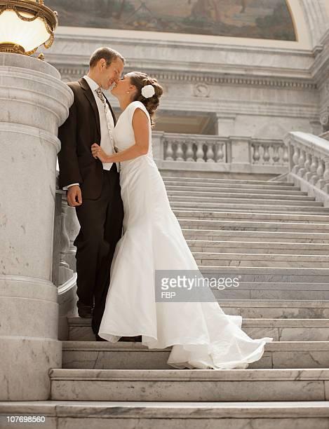 usa, utah, salt lake city, bride and groom kissing on steps - utah wedding stock pictures, royalty-free photos & images