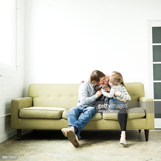 USA, Utah, Salt Lake City, Family embracing on sofa