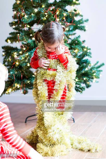 USA, Utah, Salt Lake City, Girl (4-5) decorating christmas tree