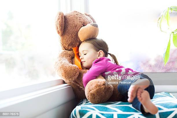 USA, Utah, Salt Lake City, Girl (4-5) embracing teddy bear