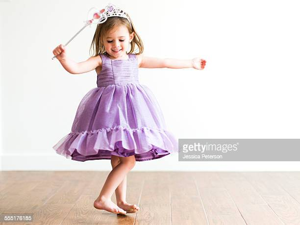USA, Utah, Salt Lake City, Girl (4-5) in princess costume dancing