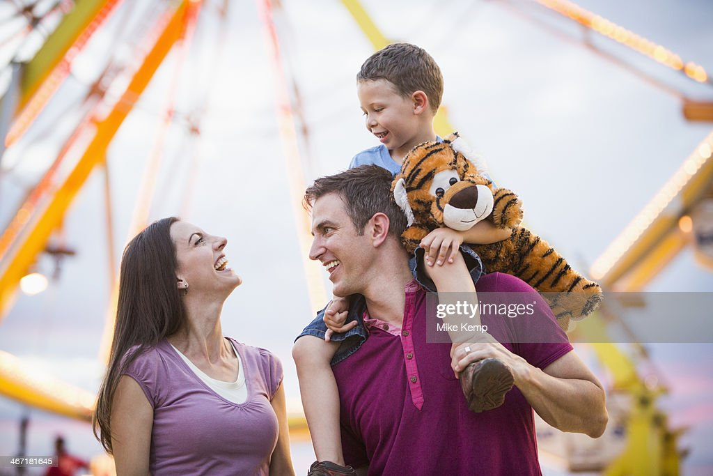 USA, Utah, Salt Lake City, Happy Family with son (4-5 ) in amusement park : Stock Photo