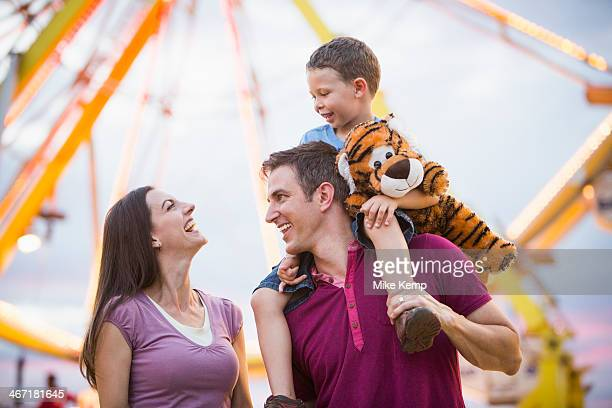 usa, utah, salt lake city, happy family with son (4-5 ) in amusement park - ferris wheel stock pictures, royalty-free photos & images
