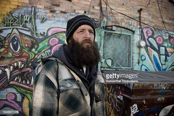 USA, Utah, Salt Lake City, homeless man near graffiti wall