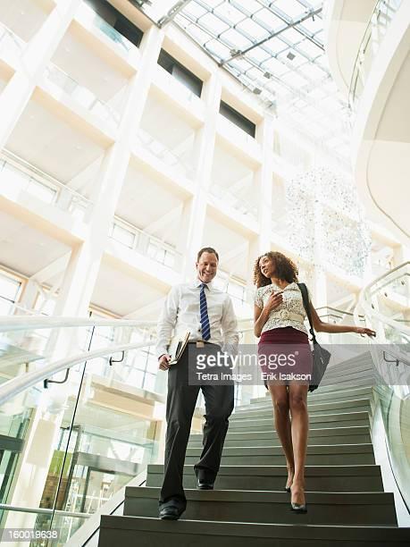 usa, utah, salt lake city, man and woman walking down stairs - down blouse stockfoto's en -beelden
