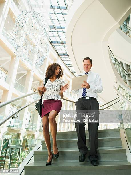 usa, utah, salt lake city, man and woman walking down stairs - down blouse stock pictures, royalty-free photos & images