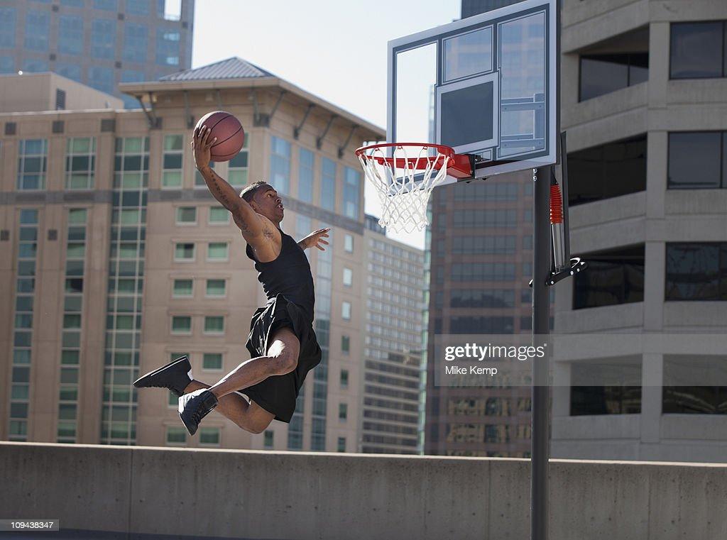 USA, Utah, Salt Lake City, man playing basketball : Stock Photo