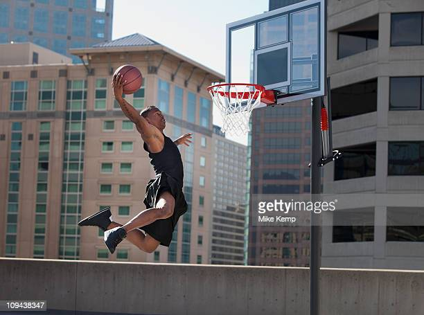 usa, utah, salt lake city, man playing basketball - shooting baskets stock photos and pictures