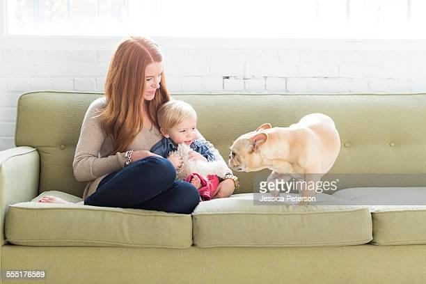 USA, Utah, Salt Lake City, Mother and son (2-3) on sofa looking at pug