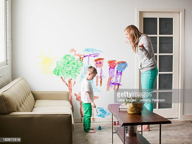 USA, Utah, Salt Lake City, Mother telling toddler boy (2-3) off for painting on walls