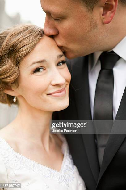 usa, utah, salt lake city, newly wed couple kissing - utah wedding stock pictures, royalty-free photos & images