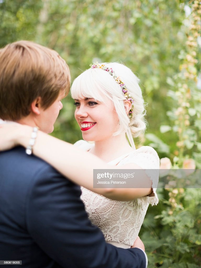 USA, Utah, Salt Lake City, Newlywed couple embracing : Stock Photo
