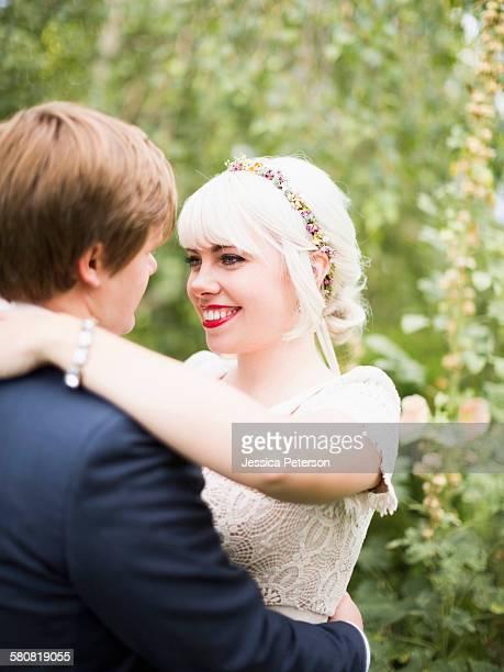 usa, utah, salt lake city, newlywed couple embracing - utah wedding stock pictures, royalty-free photos & images