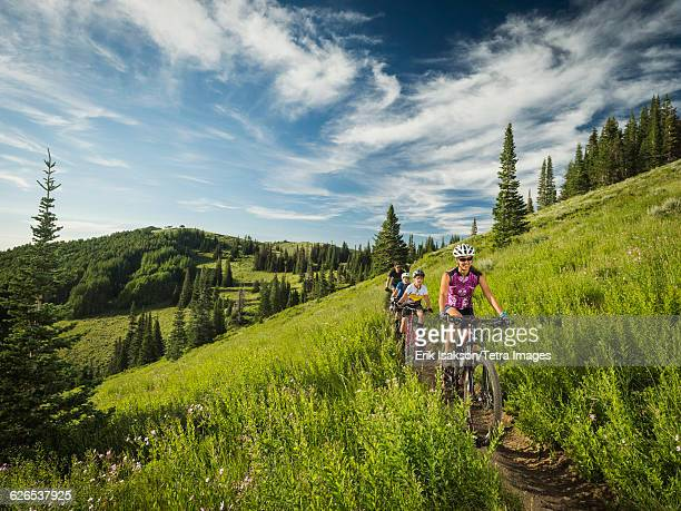 USA, Utah, Salt Lake City, Parents with sons (10-11,12-13) during bike trip