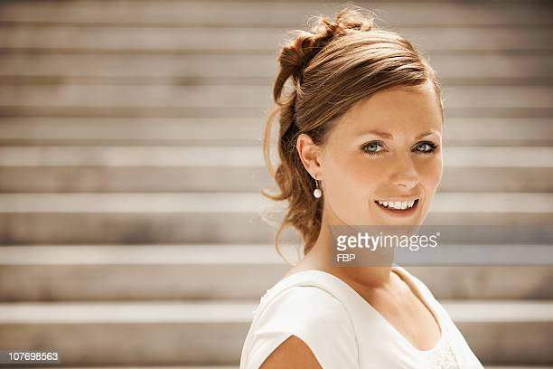 usa, utah, salt lake city, portrait of bride on steps - utah wedding stock pictures, royalty-free photos & images