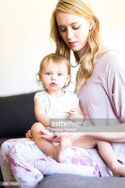 usa, utah, salt lake city, portrait of mom and her baby girl (12-17 months) - 12 23 months stock pictures, royalty-free photos & images