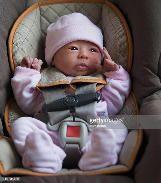 USA, Utah, Salt Lake City, Portrait of newborn girl (0-1months) in car seat