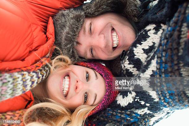 USA, Utah, Salt Lake City, Portrait of young couple lying in snow