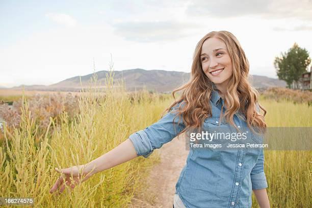 USA, Utah, Salt Lake City, Portrait of young woman on dirt road