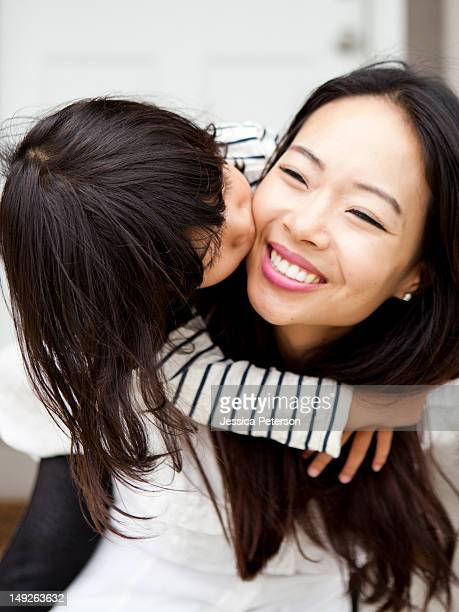 USA, Utah, Salt Lake City, Smiling woman kissing by her daughter (4-5)