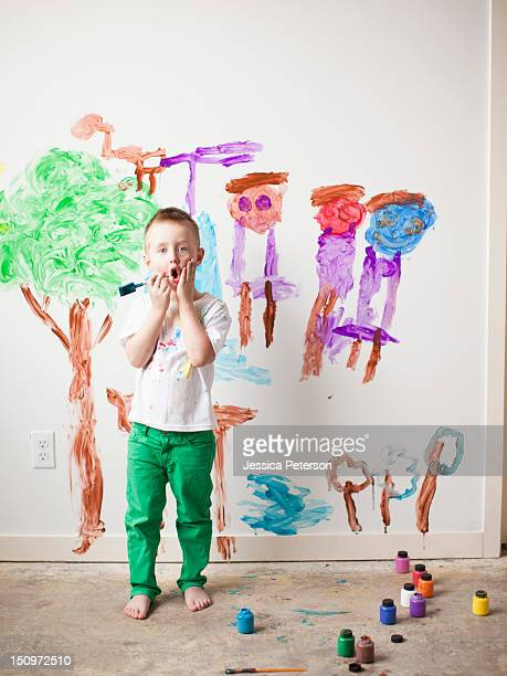 USA, Utah, Salt Lake City, Toddler boy (2-3) painting on wall