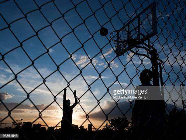 USA, Utah, Salt Lake City, two young men playing street basketball