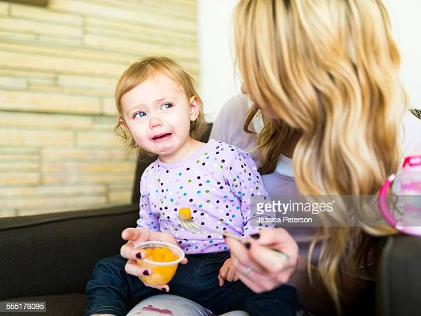 usa, utah, salt lake city, woman feeding her daughter (12-17 months) - 12 23 months stock pictures, royalty-free photos & images