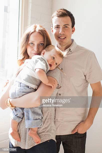 USA, Utah, Salt Lake City, Young couple embracing baby boy (6-11 months)