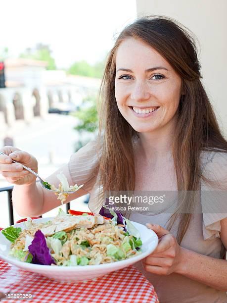 USA, Utah, Salt Lake, Portrait of young woman having salad