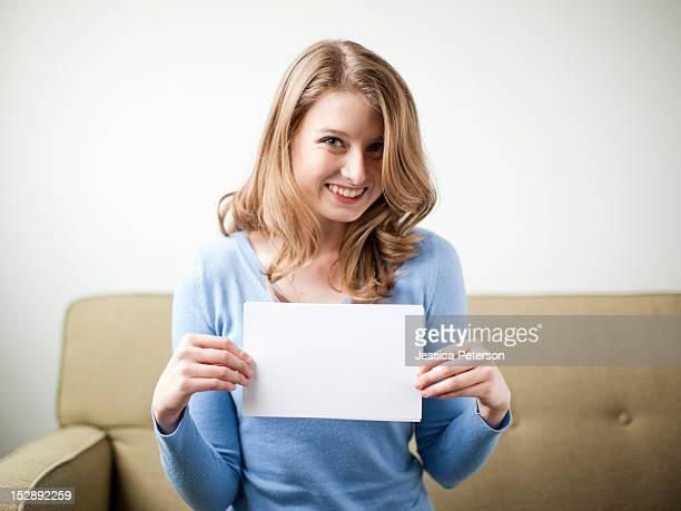 USA, Utah, Salt Lake, Smiling woman holding white page