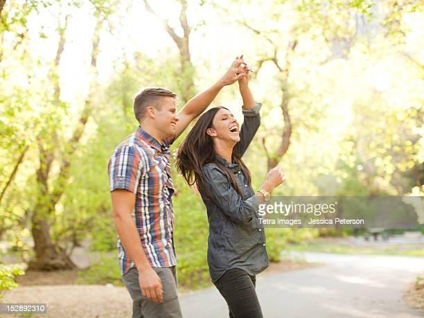USA, Utah, Salt Lake, Young couple dancing togetherness in park