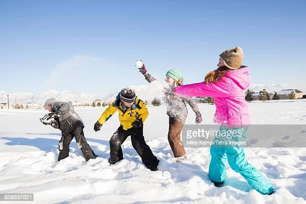 USA, Utah, Saratoga Springs, Children (8-9, 10-11) playing in snow