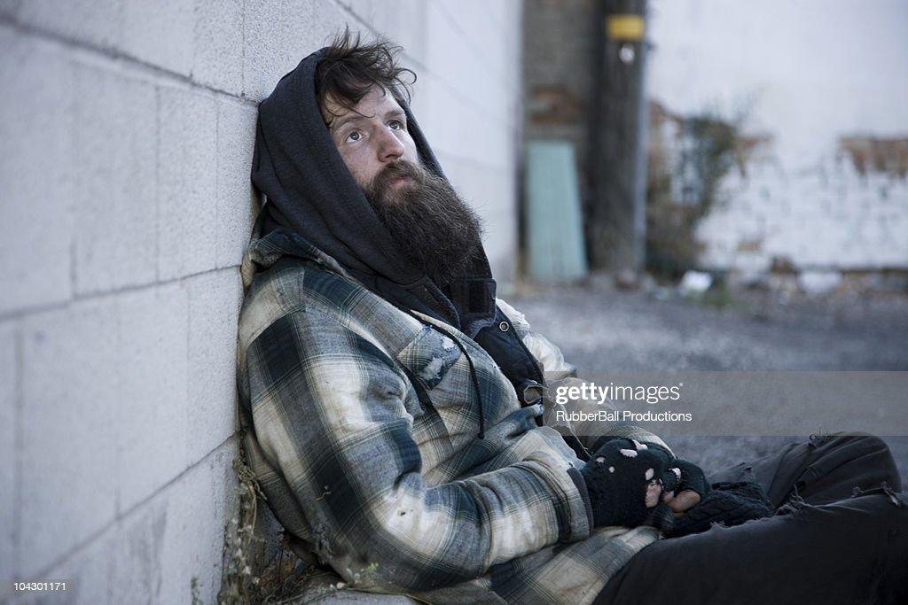 USA, Utah, Satl Lake City, homeless man leanig against wall : Stock Photo