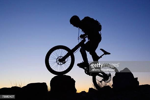 USA, Utah, silhouette of mountain biker at dusk