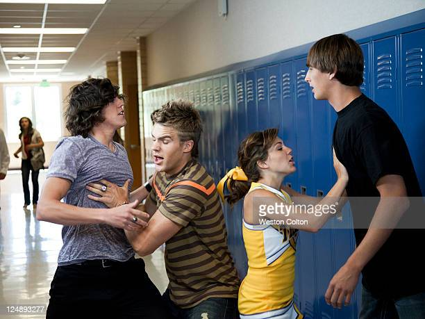 usa, utah, spanish fork, four school children (16-17) fighting in school corridor - girl fight stock photos and pictures