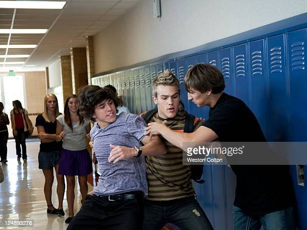 USA, Utah, Spanish Fork, Three boys (16-17) fighting in school corridor