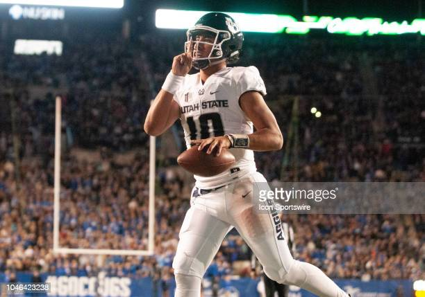 Utah State Aggies quarterback Jordan Love celebrates his touchdown by telling the fans to be quite during a college football game between the Utah...