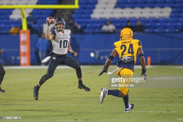 Utah State Aggies quarterback Jordan Love rolls out to pass during the Tropical Smoothie Cafe Frisco Bowl on December 20 2019 at Toyota Stadium in...