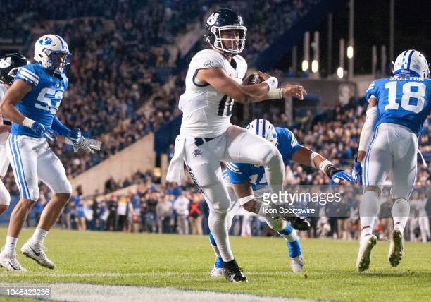 Utah State Aggies quarterback Jordan Love runs for a touchdown during a college football game between the Utah State Aggies and the BYU Cougars on...