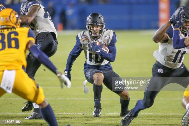 Utah State Aggies quarterback Jordan Love runs through the line during the Tropical Smoothie Cafe Frisco Bowl on December 20 2019 at Toyota Stadium...