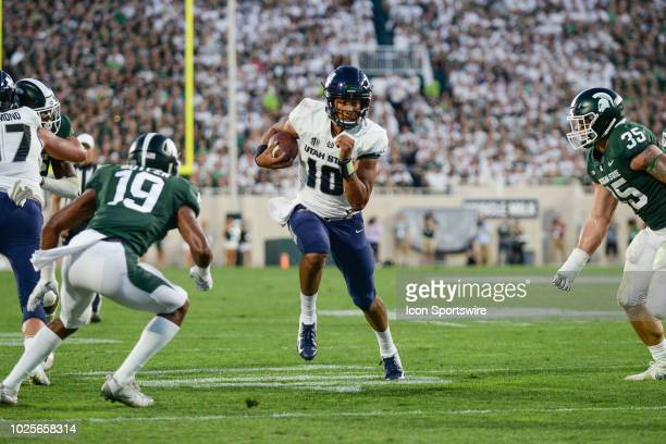 Utah State Aggies quarterback Jordan Love tries to split the Spartans defense during a nonconference college football game between Michigan State and...