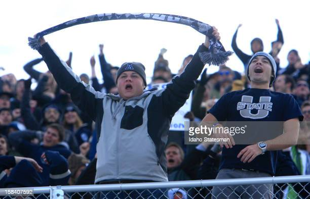 Utah State fans cheer their team before the start of play against Toledo in the Famous Idaho Potato Bowl at Bronco Stadium on Saturday December 15 in...