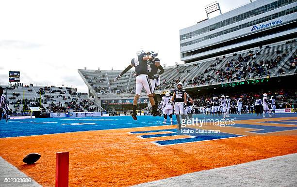 Utah State wide receiver Brandon Swindall celebrates a 9yard touchdown catch with teammate Hunter Sharp against Akron during the Famous Idaho Potato...