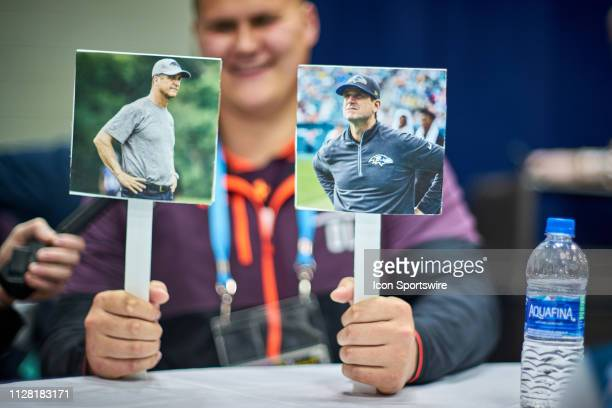 Utah tackle Jackson Barton answers questions from the media as he plays a game with a Baltimore Ravens head coach John Harbaugh pictures during the...