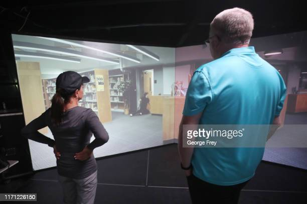 Utah teachers Coni Brooks and Tom Erekson , watch a replay of their results after they interacted with a video simulator that creates an active...