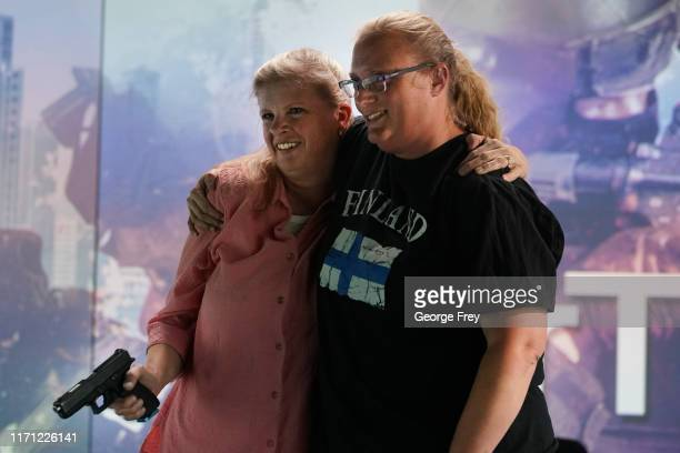 Utah teachers Sarah Scott and Shelly Brailsford , hug after they interacted with a video simulator that creates an active shooter scenario in a...